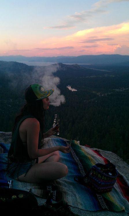 girl outside on mountain smoking dab rig