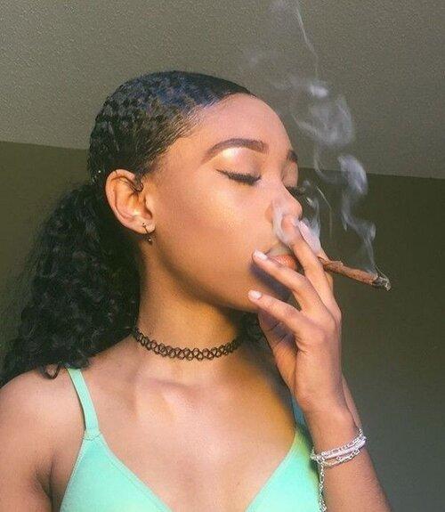 beautiful girl smoking a blunt