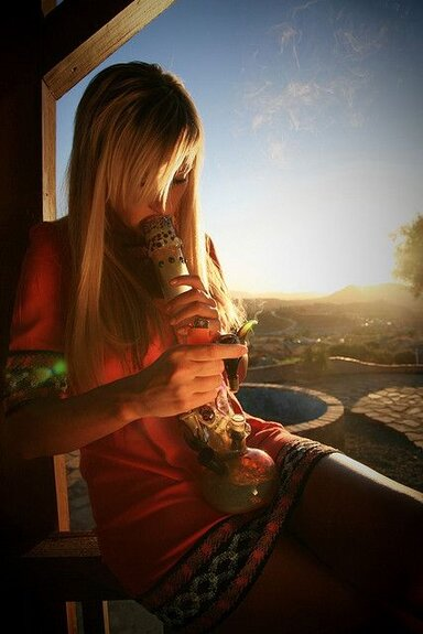 blonde girl smoking bong outside on porch