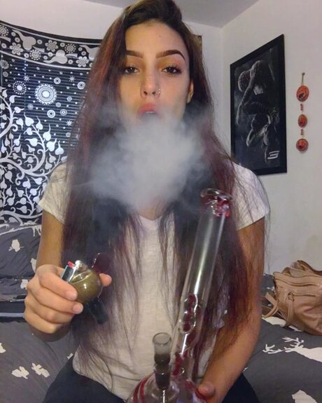 brunette girl smoking weed from bong