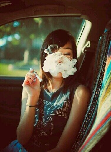 cute girl smoking in car
