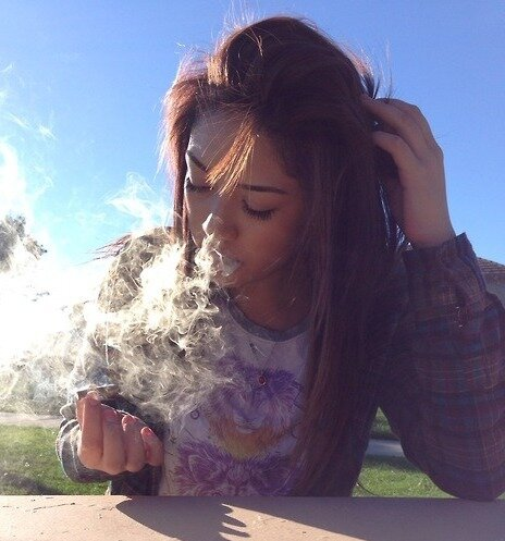 cute girl smoking joint outside