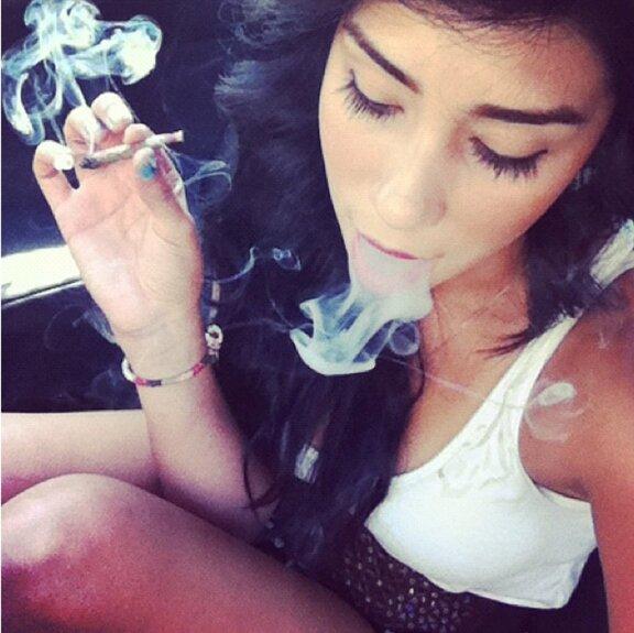 cute girl smoking marijuana joint