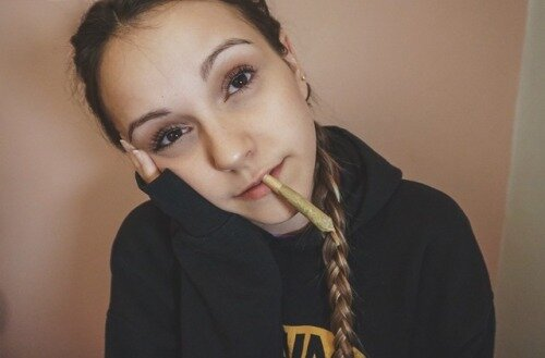 cute girl with braids smoking joint