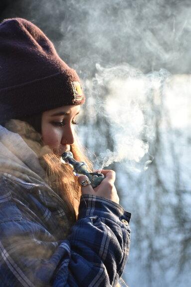 girl smoking weed pipe